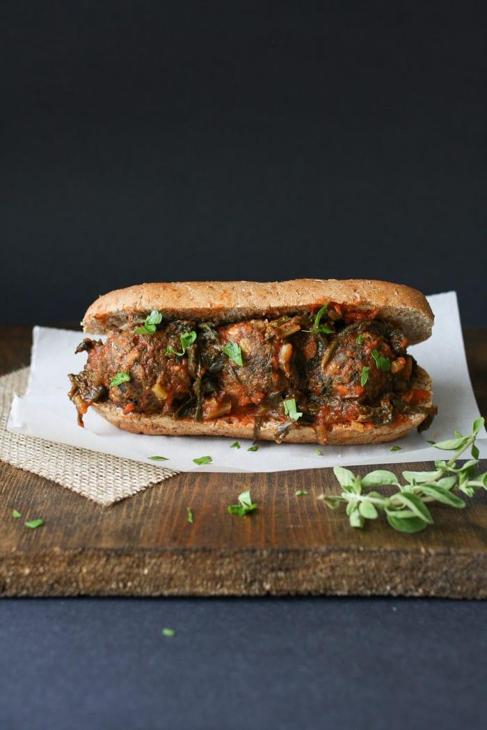 Vegan beanball sub with sautéed kale marinara sauce