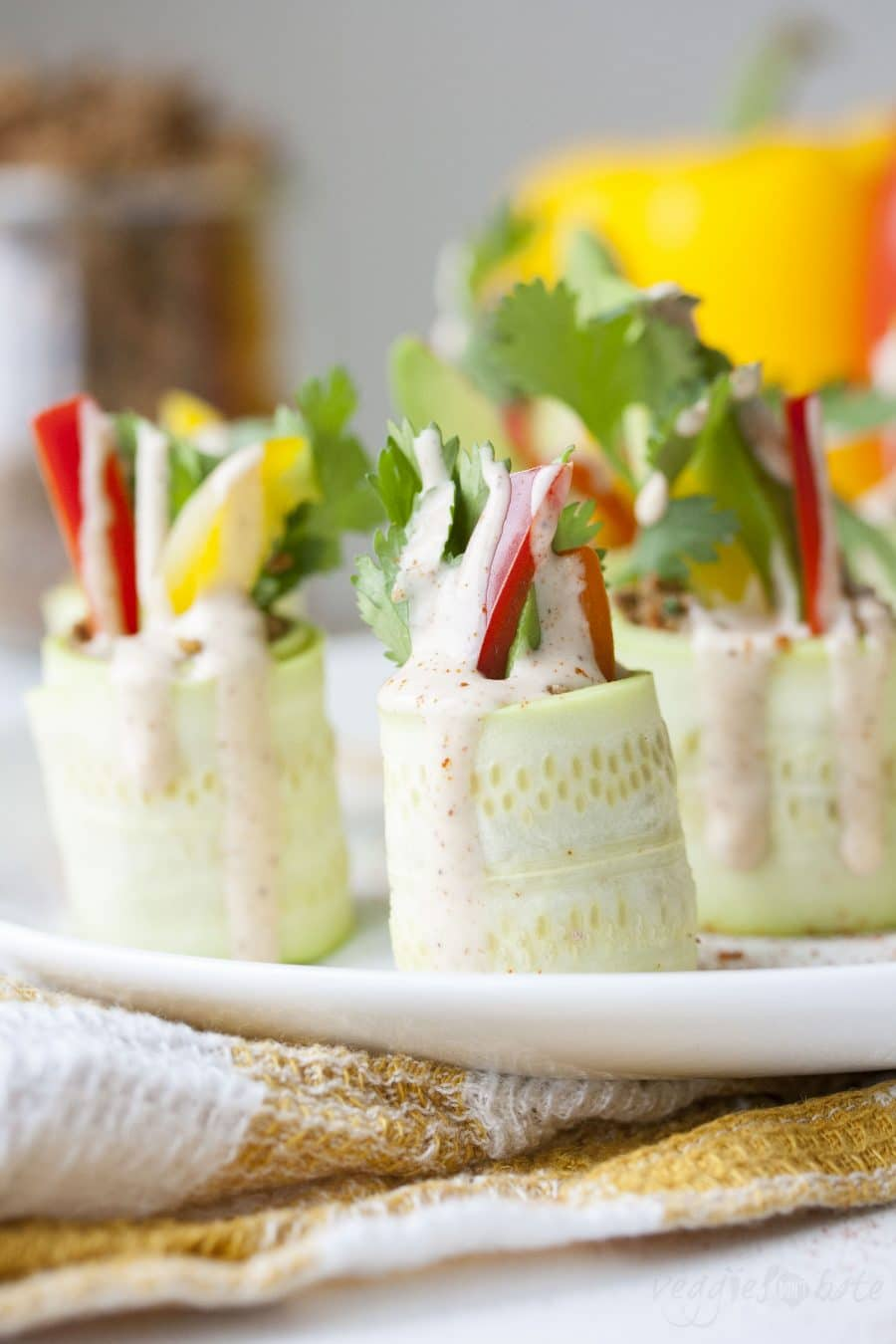"""Thinly sliced raw zucchini rolled up with veggies and raw walnut """"meat"""""""